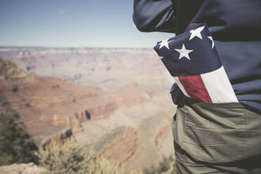 USA, Grand Canyon, man with American Flag in his pocket, partial view - EPF00386