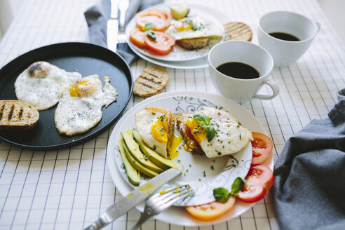 Breakfast for two, eggs, avocado, coffee, tomatoes - GIOF02162