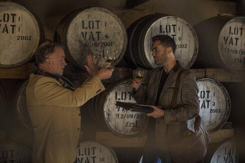 People in distillery tasing whiskey - ZEF13146