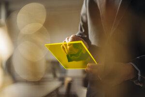 Businessman using futuristic portable device - KNSF01140