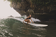 Indonesia, Java, woman surfing - KNTF00683