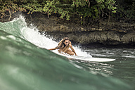 Indonesia, Java, woman surfing - KNTF00689