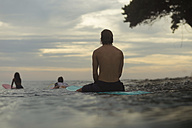 Indonesia, Java, surfers on surfboard on the sea waiting for a wave - KNTF00692
