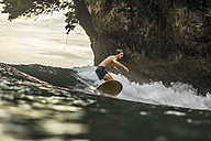 Indonesia, Java, man surfing - KNTF00695
