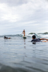 Indonesia, Java, surfers in the ocean - KNTF00707