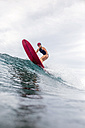 Indonesia, Java, woman surfing - KNTF00710