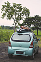 Indonesia, Java, car with surfboards on the roof - KNTF00713