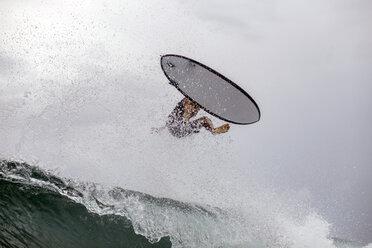 Indonesia, Java, man surfing - KNTF00716