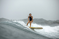 Indonesia, Java, woman surfing - KNTF00719