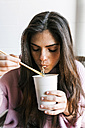 Young woman eating Chinese noodles - VABF01246