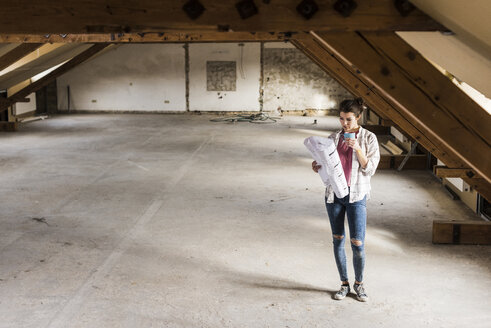 Young woman contemplating the renovation of her new home - UUF10087