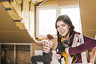 Independent young woman renovating her new home - UUF10135