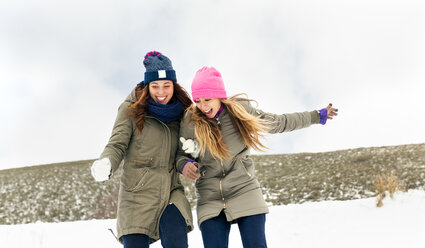 Two friends having fun in the snow - MGOF03023