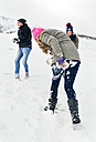 Three friends having fun in the snow - MGOF03029