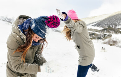 Friens having a snowball fight in the snow - MGOF03035