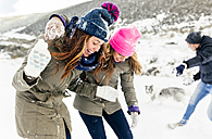 Friens having a snowball fight in the snow - MGOF03038