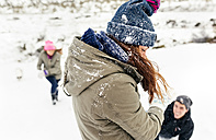 Friens having a snowball fight in the snow - MGOF03041