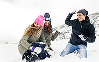 Friens having a snowball fight in the snow - MGOF03047