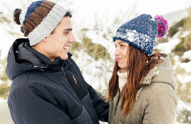 Couple in love standing in the snow - MGOF03068