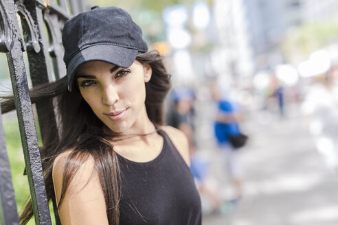 Portrait of young woman wearing cap outdoors - GIOF02217