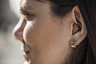 Young woman with hearing aid, close-up - ZEDF00552