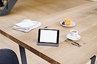 Tablet on wooden table - KNSF01146