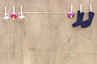 Pacifiers and baby's socks on clothesline - CMF00664