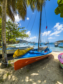 Caribbean, St. Vincent And The Grenadines, Bequia, bay of Port Elisabeth with colorful sailing ships on the beach - AMF05333