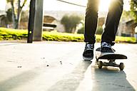 Legs of a skateboarder in a skatepark - KKAF00518