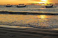 Indonesia, Bali, sunset over the ocean with boats - KNTF00743