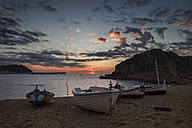 Spain, Catalonia, Blanes, beach sunrise at Mediterranean Sea - ABOF00164
