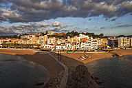 Spain, Catalonia, Blanes, beach and hotels at the sea at sunrise - ABOF00167