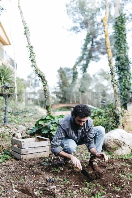 Man planting in his garden - JRFF01259
