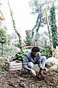 Man planting in his garden - JRFF01259