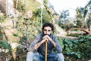 Man in garden having a break from gardening - JRFF01277