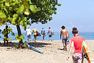 Indonesia, Bali, surfers walking to the ocean - KNTF00750