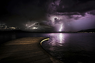 Italy, thunderstorm at a lake at night - SIPF01459