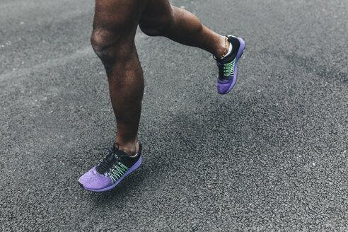 Close-up of man running on street - BOYF00686