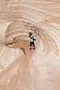 USA, Paria Canyon, Vermillion Cliffs, Page, tourist inside rock formation Nautilus - FOF09038