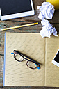 Notepad, spectacles, tablet, pencil, cell phone and crumpled paper - GIOF02256