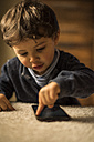 Toddler playing with smartphone - JASF01572