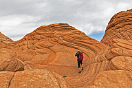 USA, Arizona, Page, Paria Canyon, Vermillion Cliffs Wilderness, Coyote Buttes, red stone pyramids and buttes, tourist taking a picture - FOF09062