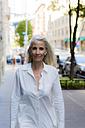 USA, Brooklyn, portrait of content businesswoman - GIOF02298