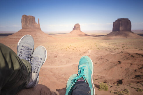 USA, Utah, feet of couple resting at Monument Valley - EPF00394