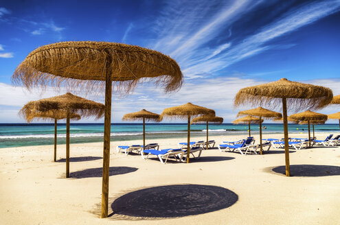 Spain, Menorca, Son Bou, beach with sunshades - SMA00708