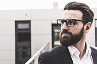 Portrait of a bearded, young businessman , wearing spectacles - UUF10180