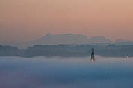 Germany, Constance, spire of Constance minster emerging from sea of fog - KEBF00544
