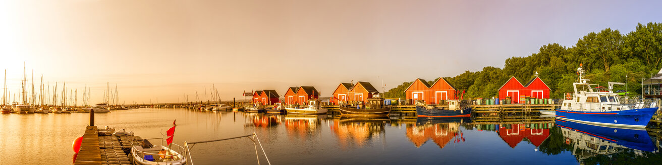 Germany, Ahrenshoop, view to fishing harbour at sunset - PUF00595