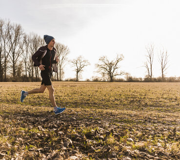 Man running in rural landscape - UUF10206