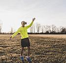 Athlete wearing VR glasses in rural landscape - UUF10212